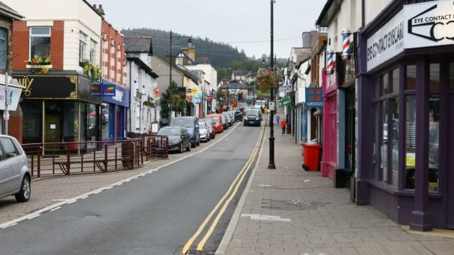 cars drive down the high street where a number of the shops have closed in preparation for the localised lockdown on september 08 2020 in caerphilly... - reaching stock videos & royalty-free footage