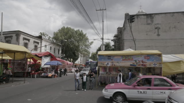 cars drive narrow streets in mexico city - mexico stock videos & royalty-free footage