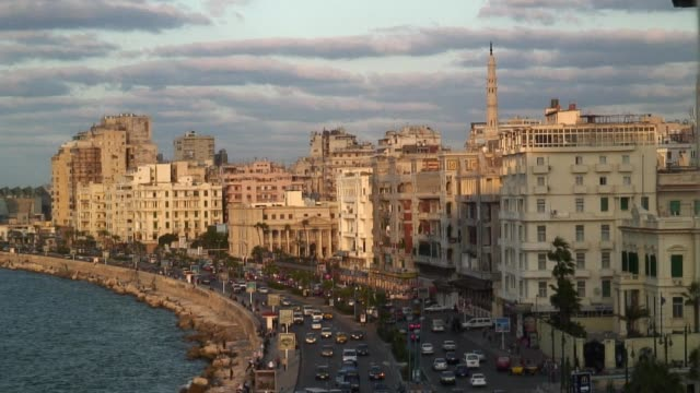Cars drive near the Mediterranean Sea in the city of Alexandria.