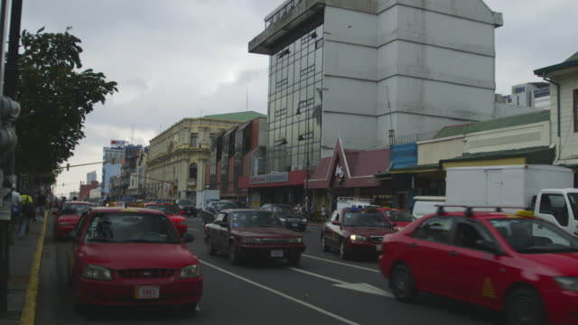 Cars drive on busy street in Costa Rica