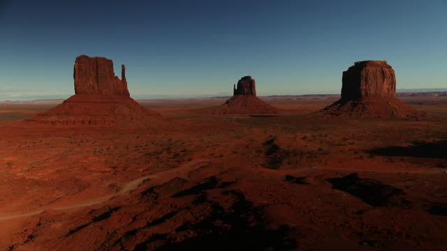 cars drive on road through monument valley time lapse wide shot - wilderness stock videos & royalty-free footage
