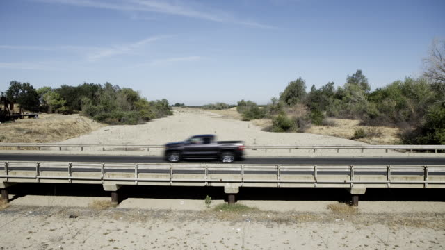 Cars drive over bridge