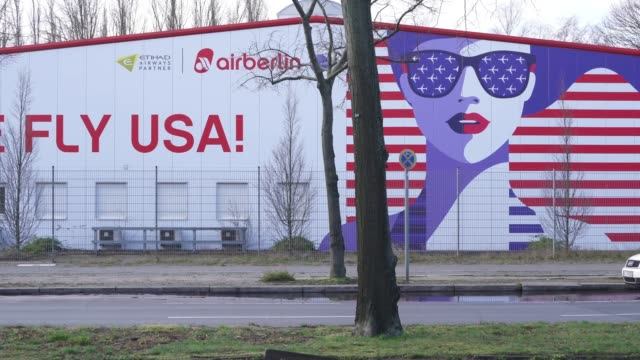 cars drive past an old air berlin advertisement promoting the defunct airline's flights to the usa hours before the trump european travel ban goes... - travel stock videos & royalty-free footage