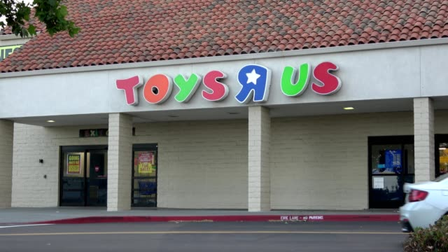 Cars drive past facade of Toys R Us store in Dublin California following the company's bankruptcy May 21 2018