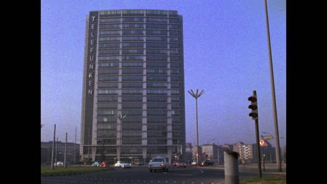 cars drive past telefunken building in west berlin; 1969 - germany stock videos & royalty-free footage
