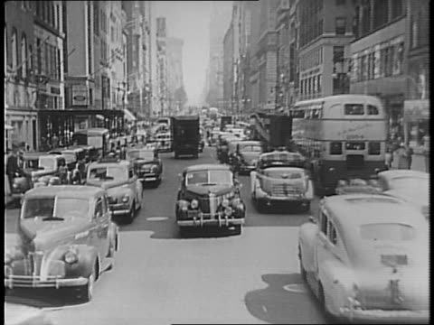 cars drive through city street / montage of signs proclaiming restricted hours at gas stations / harold l ickes makes statement on importance of oil... - the march of time stock videos & royalty-free footage