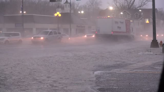 cars drive through flooding streets in st louis on april 7 2015 - st. louis missouri stock videos and b-roll footage