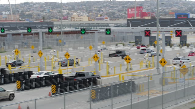 cars drive to mexico after went through security checkpoints. - security system stock videos & royalty-free footage