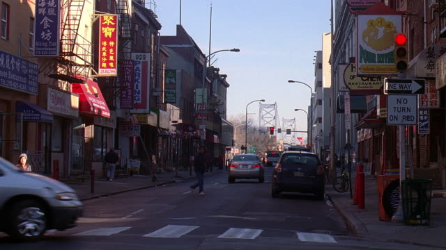 ws cars driving and pedestrians walking through streets of chinatown / philadelphia, pennsylvania, united states - pennsylvania stock videos & royalty-free footage