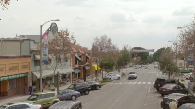cs cars driving by and parked in front of various stores / sierra madre, california, united states - sierra madre stock-videos und b-roll-filmmaterial