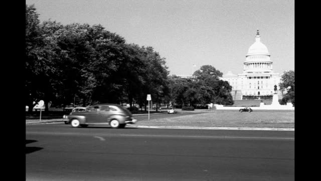 Cars driving by Capitol Building Cars driving by Capitol Building on January 01 1930 in Washington DC