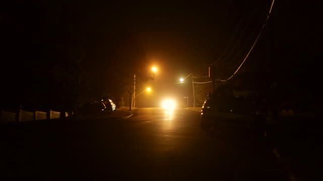cars (2) driving by night in residential area - suburban stock videos and b-roll footage