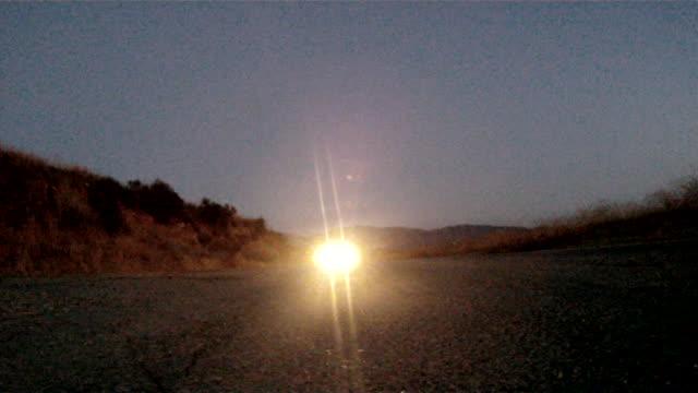 LA Cars driving down a desert road.