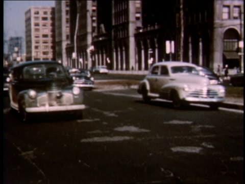 stockvideo's en b-roll-footage met 1951 ws cars driving down grand boulevard / detroit, michigan, united states - boulevard