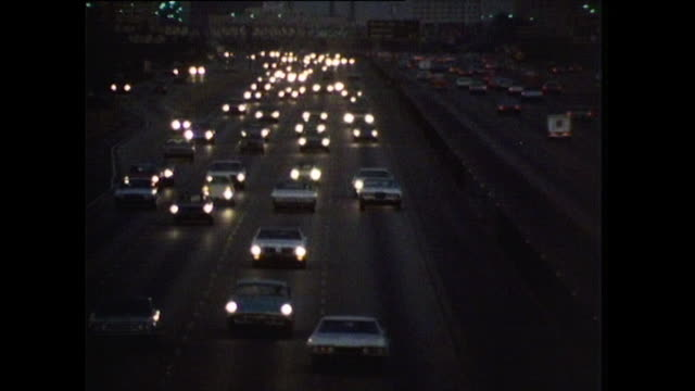 cars driving down los angeles freeway at night; 1972 - city of los angeles stock videos & royalty-free footage