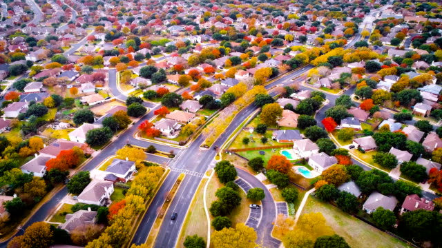cars driving home and to work fall foliage autumn suburb neighborhood aeiral drone view high above expanding housing development - modern rock stock videos & royalty-free footage