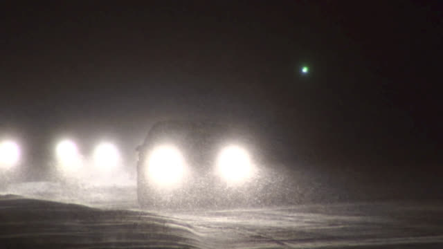cars driving in heavy snow at night. - wichita stock videos & royalty-free footage