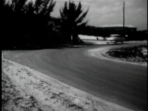 stockvideo's en b-roll-footage met 1956 b/w montage ws pan ms ts pov cars driving in rural and urban areas / usa / audio - meer dan 50 seconden