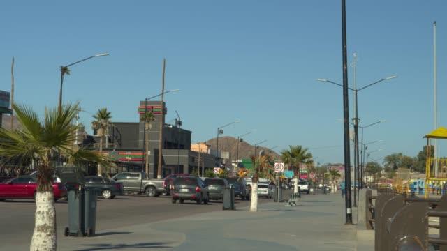 cars driving in street under blue sky / san felipe, baja california norte, mexico - baja california norte stock videos & royalty-free footage