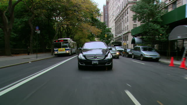 TS / REAR VIEW /POV of cars driving on 5th Ave in Manhattan / New York, NY