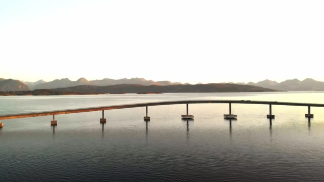 cars driving on a bridge, connecting the fjords - aerial footage - coastal feature stock videos & royalty-free footage