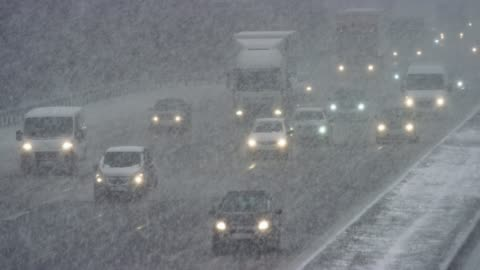 ld cars driving on a highway in a heavy snow storm - cold temperature stock videos & royalty-free footage
