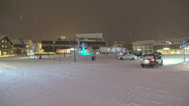 ws cars driving on a snowy road in town - town stock videos & royalty-free footage