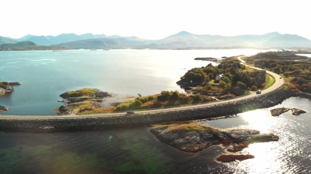 cars driving on atlantic road - aerial drone footage - atlantic ocean stock videos & royalty-free footage