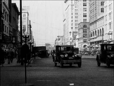 b/w 1927 cars driving on city street / dayton, ohio / industrial - ohio stock videos & royalty-free footage