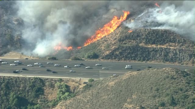 ktla cars driving on freeway alongside wildfire on may 03 2013 in camarillo california - camarillo stock videos & royalty-free footage