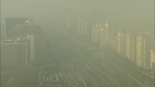 WS HA Cars driving on freeway in smog / Beijing, China