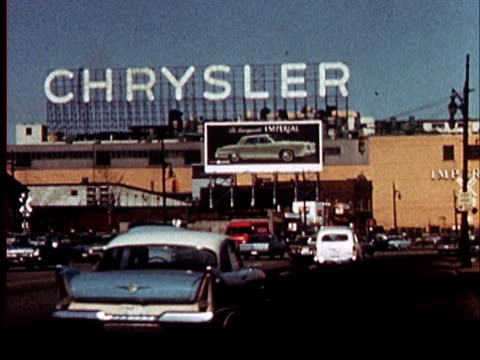 stockvideo's en b-roll-footage met 1965 ws cars driving on freeway towards billboard advertising imperial model chrysler car/ detroit, michigan - chrysler