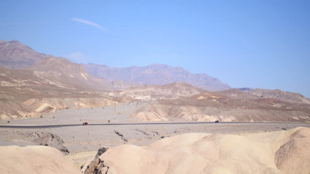 cars driving on highway in death valley national park - wide stock videos and b-roll footage