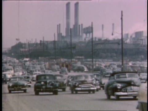 vídeos de stock e filmes b-roll de 1951 ws cars driving on highway in front of auto factory / detroit, michigan, united states - 1950