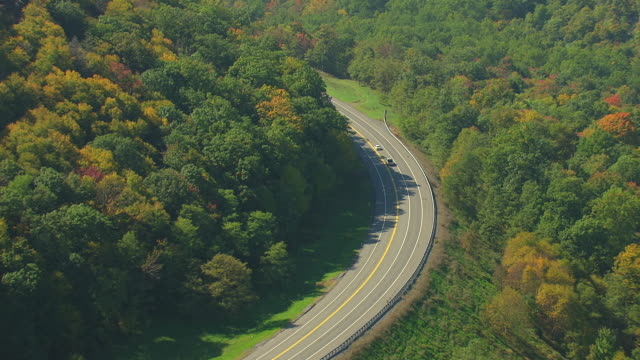 MS AERIAL TS Cars driving on highway through Appalachian Mountains / Pennsylvania, United States