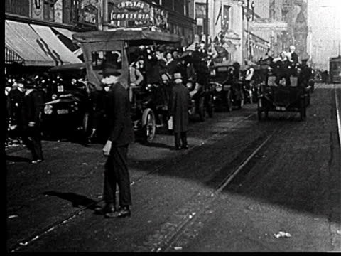 cars driving on street in liberty loan parade / san francisco / newsreel - 1918 stock videos & royalty-free footage