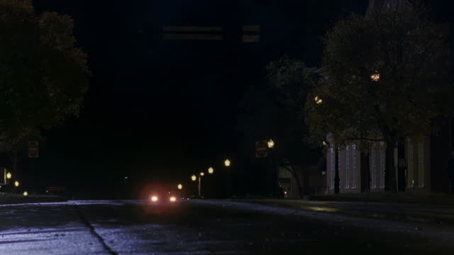 TS Cars driving on the street in a small town at night / Georgia, United States