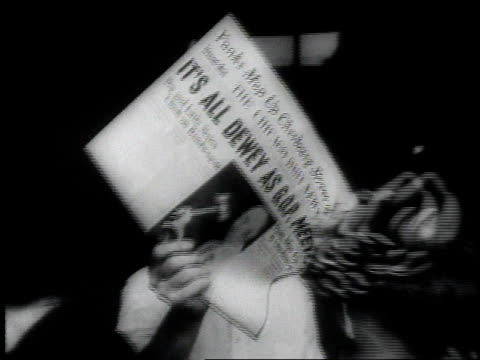 stockvideo's en b-roll-footage met cars driving on the street / man selling newspaper / people arriving for the convention / crowd of people attending the convention - 1946