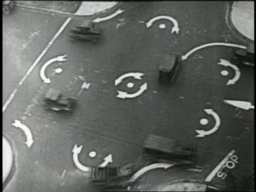 b/w 1924 overhead cars driving on traffic circle at intersection / feature - slapstick comedy stock videos & royalty-free footage