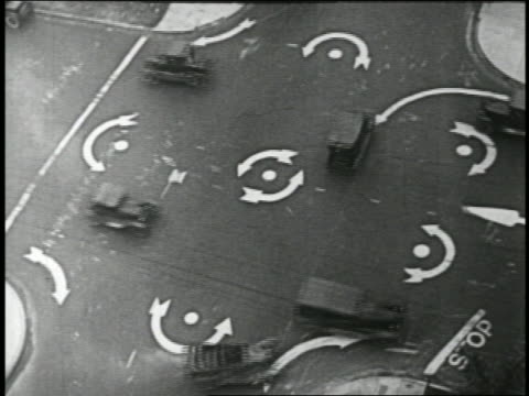 b/w 1924 overhead cars driving on traffic circle at intersection / feature - slapstick stock videos & royalty-free footage
