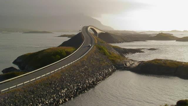 WS HA Cars driving over Storseisundet bridge on Atlantic road / More og Romsdal, Norway