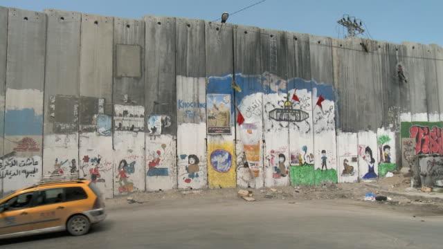 MS PAN Cars driving past Israeli West Bank wall / Jerusalem, Israel
