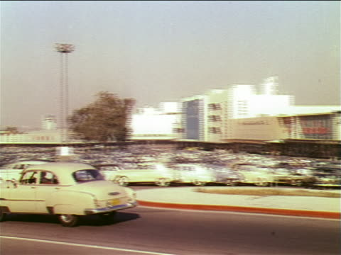 1951 pan cars driving past shopping center parking lot / industrial - horseless carriage stock videos & royalty-free footage