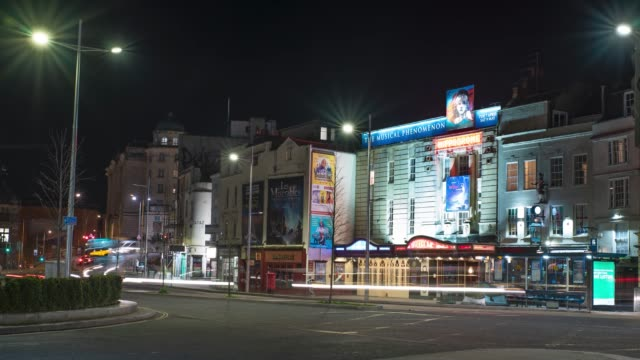 cars driving past the historic bristol hippodrome theatre at night in bristol united kingdom - light trail stock videos & royalty-free footage
