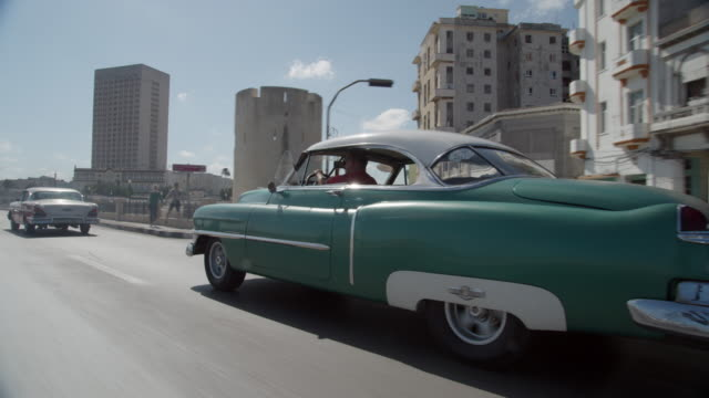 cars driving through cuba - cuba stock videos and b-roll footage