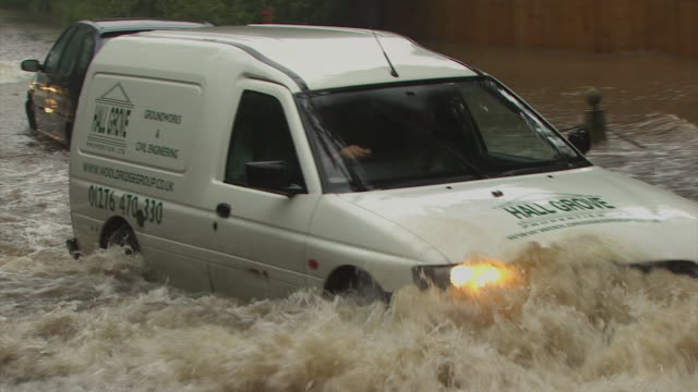 cu of cars driving through flash flooded road, england, uk - stranded stock videos and b-roll footage