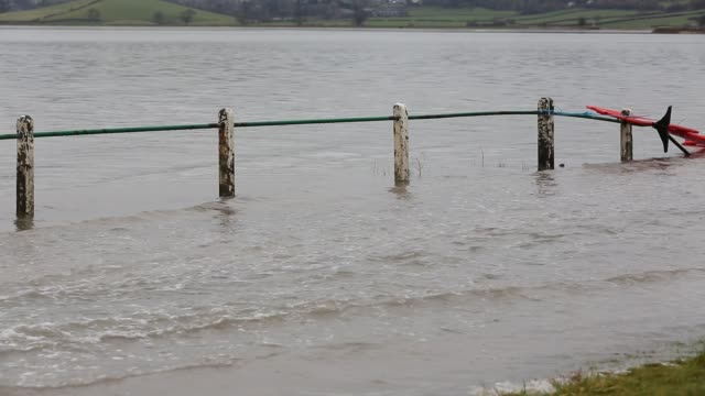 cars driving through flood waters on the road at storth on the kent estuary in cumbria, uk, during the january 2014 storm surge and high tides. - power in nature stock videos & royalty-free footage