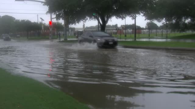 cars driving through flooded roadway - environment or natural disaster or climate change or earthquake or hurricane or extreme weather or oil spill or volcano or tornado or flooding stock videos & royalty-free footage