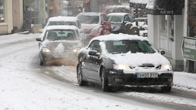cars driving through heavy snow in ambleside, lake - blizzard stock videos & royalty-free footage