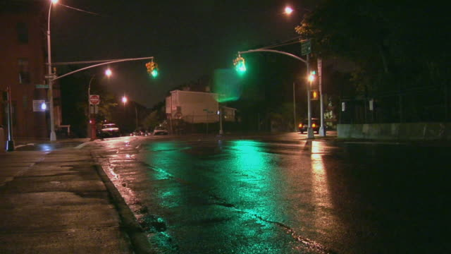 ws cars driving through intersection on rainy night / windsor terrace, brooklyn, ny - tail light stock videos & royalty-free footage